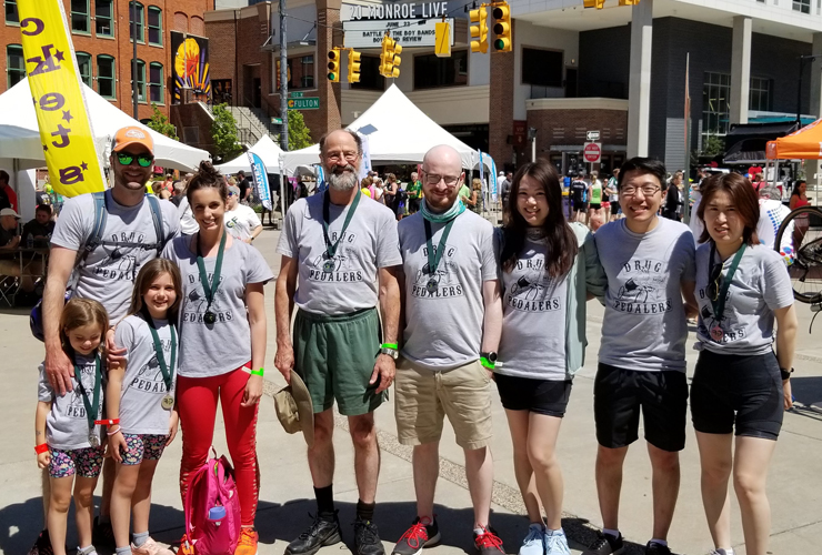 Photo of research team at the MSU Gran Fondo finish line festival